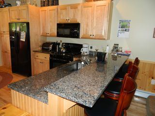 Carrabassett Valley condo photo - Granite bar with bar stools for additional seating