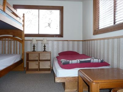 Bedroom with bunk and single bed
