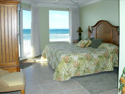 Master bedroom suite with balcony access and incredible beach view