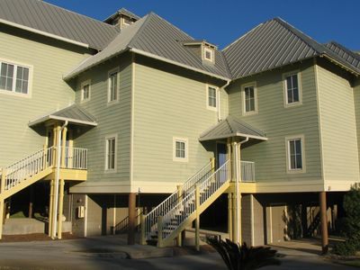 "The Gathering Place - The front door at The Gathering Place. Just steps away from covered parking and storage space for your ""beach stuff""."