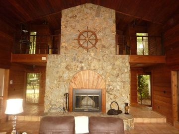 Enjoy the large fireplace on a cool evening while watching the river traffic.
