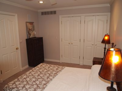 Another view of a main level bedroom with full bed and large closet space.