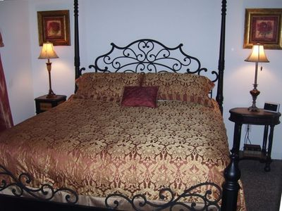 Master bedroom with king size bed and comfortable pillow top mattress.