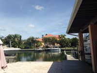 Longboat Key's rare location!Beautiful  bay front house with a private dock!