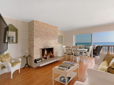 Oceanfront living area with wood burning fire place and flat screen HD TV