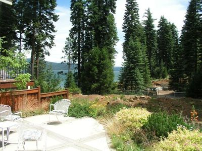 Backyard has very private views of the lake with fire pit, gas & charcoal BBQs