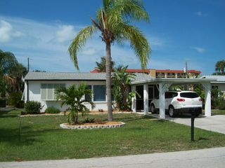 Fort Myers Beach house photo - The front of the house has lush landscaping with palms, bird of paradise, etc.