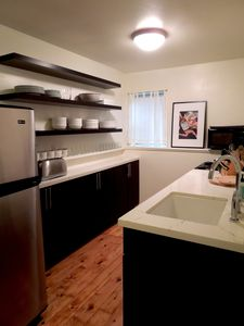 Fully equipped kitchen with gas stove, dishwasher, microwave, coffee maker etc.