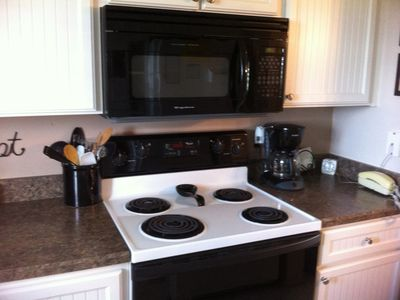 Flagler Beach condo rental - Kitchen with all utensils and free local calls on your telephone.