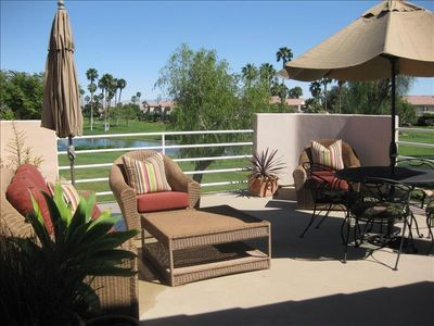 Huge outdoor Patio deck overlooking the golf course.  BBQ and couch, chairs for