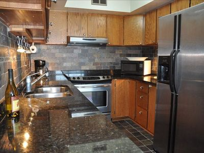 Our fully equipped kitchen has been updated with granite and stainless steel.