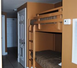 Calypso Resort condo photo - Bunk Area w/ Full Bath Across Hall -- Queen sleeper sofa in LR with gulf view
