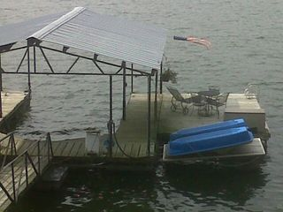 Restful swim dock and paddleboat for guest usage. - Gravois Mills house vacation rental photo