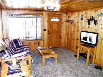 Flat-Screen TV and Futon in the Front Cabin's Living Room