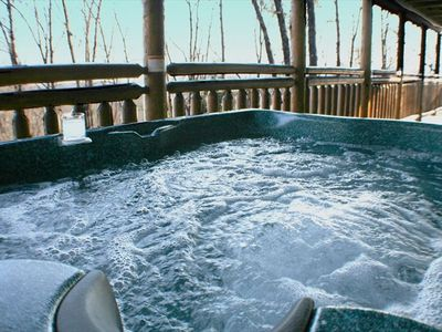 Soak your stress away in the private hot tub on the covered deck
