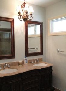 Bathroom for bedroom 3 & 4. Has double sinks + shower/tub.  Recently remodelled.