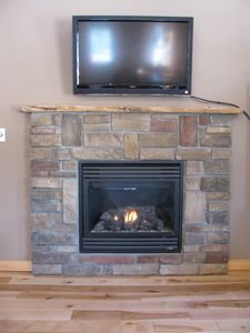 Bethel cabin rental - Warm up by the Gas Fireplace