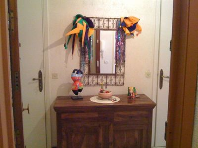 colorful foyer upon entry- full bath to the right; 2nd toilet left