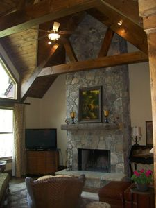 Vaulted/Beamed ceiling and large stone fireplace create a dramatic living space