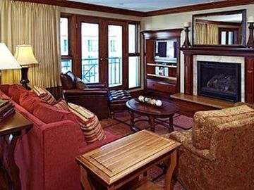 Living room with Gas fireplace ad balcony overlooking ice rink / village