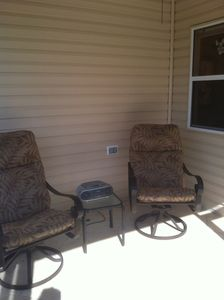 Front Patio with lounge chairs and foot rests