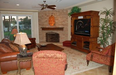 Relaxing great room  with big screen television and gas log fireplace