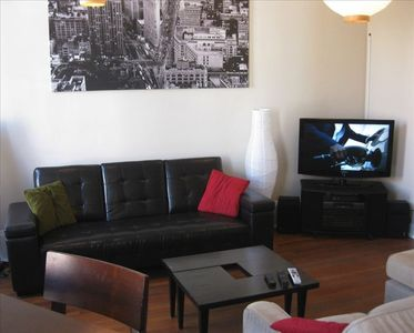 "Living Room with 46"" Flat Panel Television & DirecTV / DVD player"