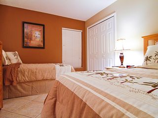 Emerald Island villa photo - The middle bedroom has 2 twin beds large closet, 32in HDTV and is warm and cozy!