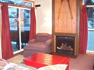 Living Room w/ Fireplace Notice View of Lift through Window Ski In Ski Out