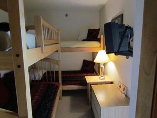 "Newry condo photo - ""Kids room"" has 4 bunk beds and TV with DVD and VCR. Small library of kids movie"