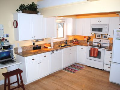 Open kitchen with slab granite and WIFI/Broadband workstation