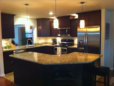 All new kitchen with granite tops open floor plan to lanai, dinning & living