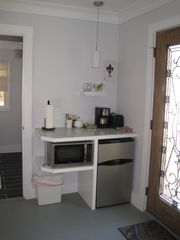 Ocean Springs cottage photo - Kitchenette area in Lagniappe with mini-frig, microwave, coffee pot and toaster.