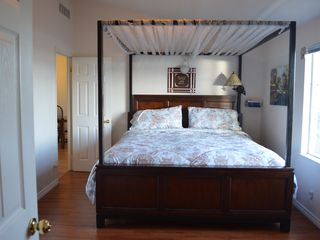Bodega Bay house photo - Canopy King size bed in master bedroom with own TV and bay view through windows.