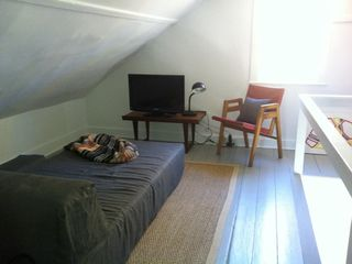 Chatham farmhouse photo - Sleeping alcove off Main House Upper Bedroom or lounging, tv and reading loft.
