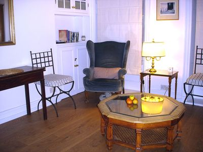 SITTING ROOM showing the coffee table and two of the four dining chairs.