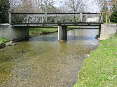 stream and bridge across street