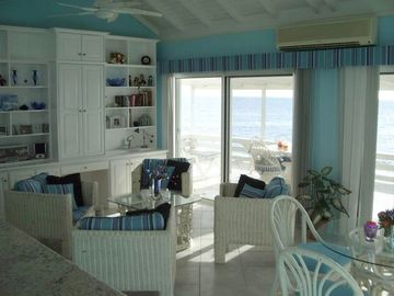 Library/computer and sitting areas with deck & turquoise sea thru sliding doors