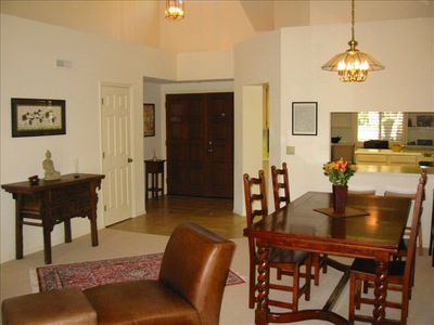 Entry way, dining area and kitchen