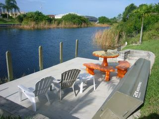 Cape Coral house photo - dock, concrete table, small boat, fresh water canal