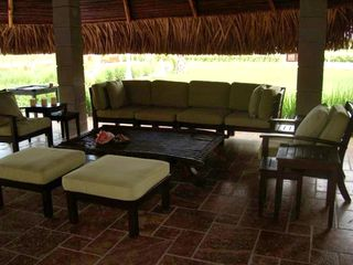 "The ""Rancho"" cool area next to swimming pool, living room and dining table"