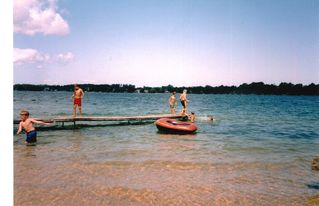 Traverse City cottage photo - 100 ft private beach, sandy lake bottom and dock