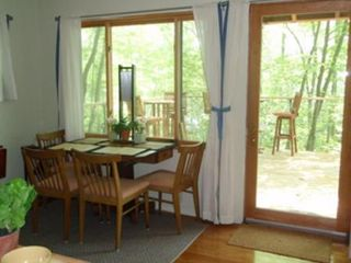 North Stonington house photo - Dining area faces deck/lake. Part of the living-in-a-tree-house feeling!