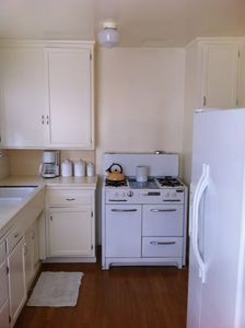 The well equipped kitchen has classic fully functioning and modern appliances.