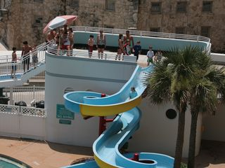 Always popular water slide at the south pool in the Ocean Walk. - Daytona Beach condo vacation rental photo