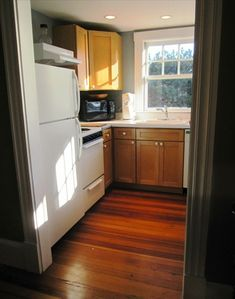 Kitchen with elec. stove, microwave, d/w, coffeemaker and toaster.