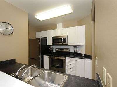 Fully equipped kitchen, new stainless steel appliances.