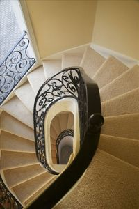 Custom hand crafted wrought iron  staircase servicing all three levels