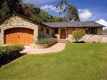Hope Ranch house rental - This cozy, stone house with wood doors is the perfect place for dog lovers, who can take their dog to the beach just blocks away.
