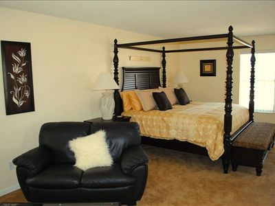 Master Suite 1 with Four Poster King Bed and Couch